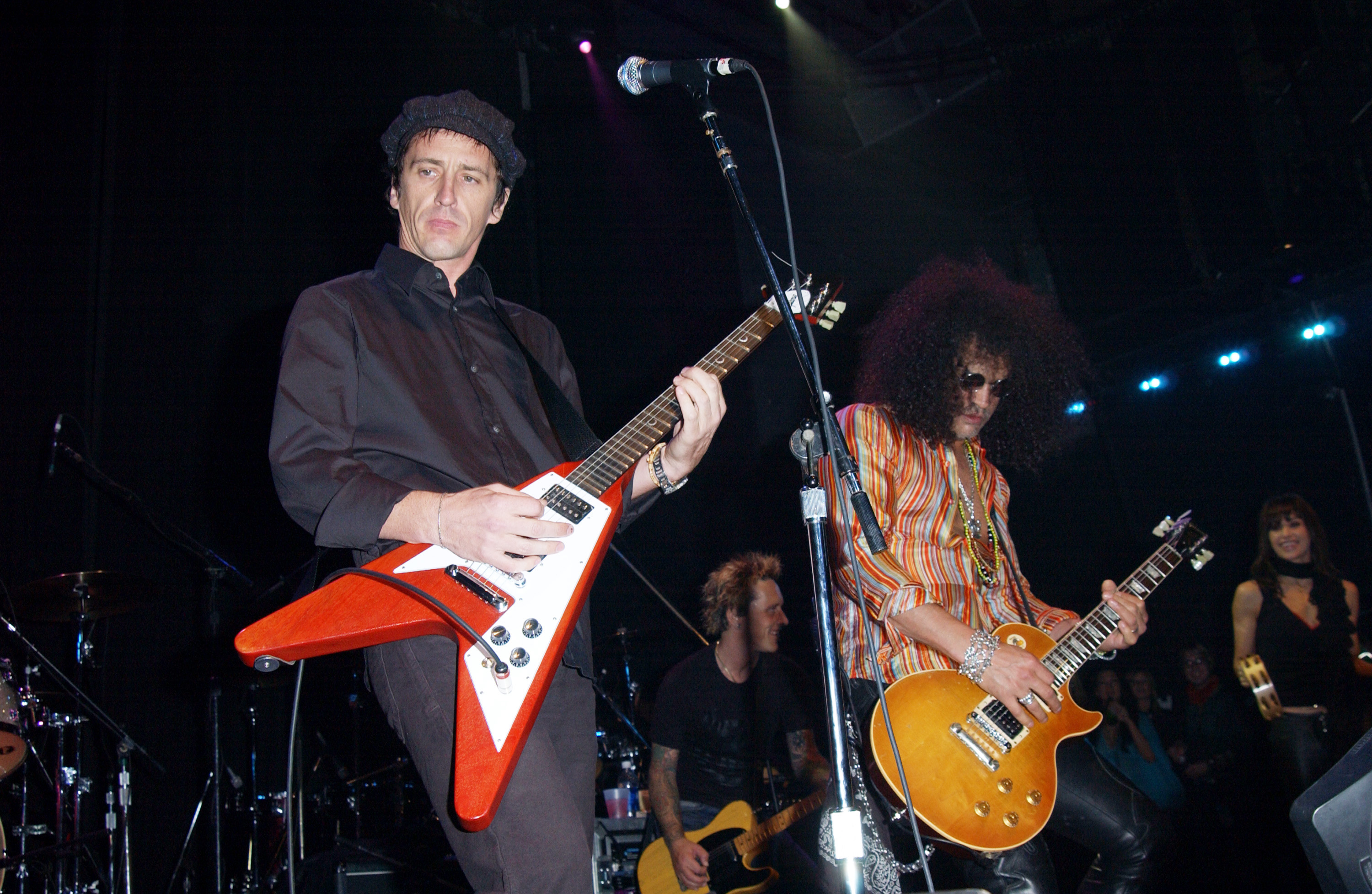 Izzy Stradlin and Slash during DKNY Presents Vanity Fair 'In Concert' To Benefit Step Up Women's Network - Concert at Avalon