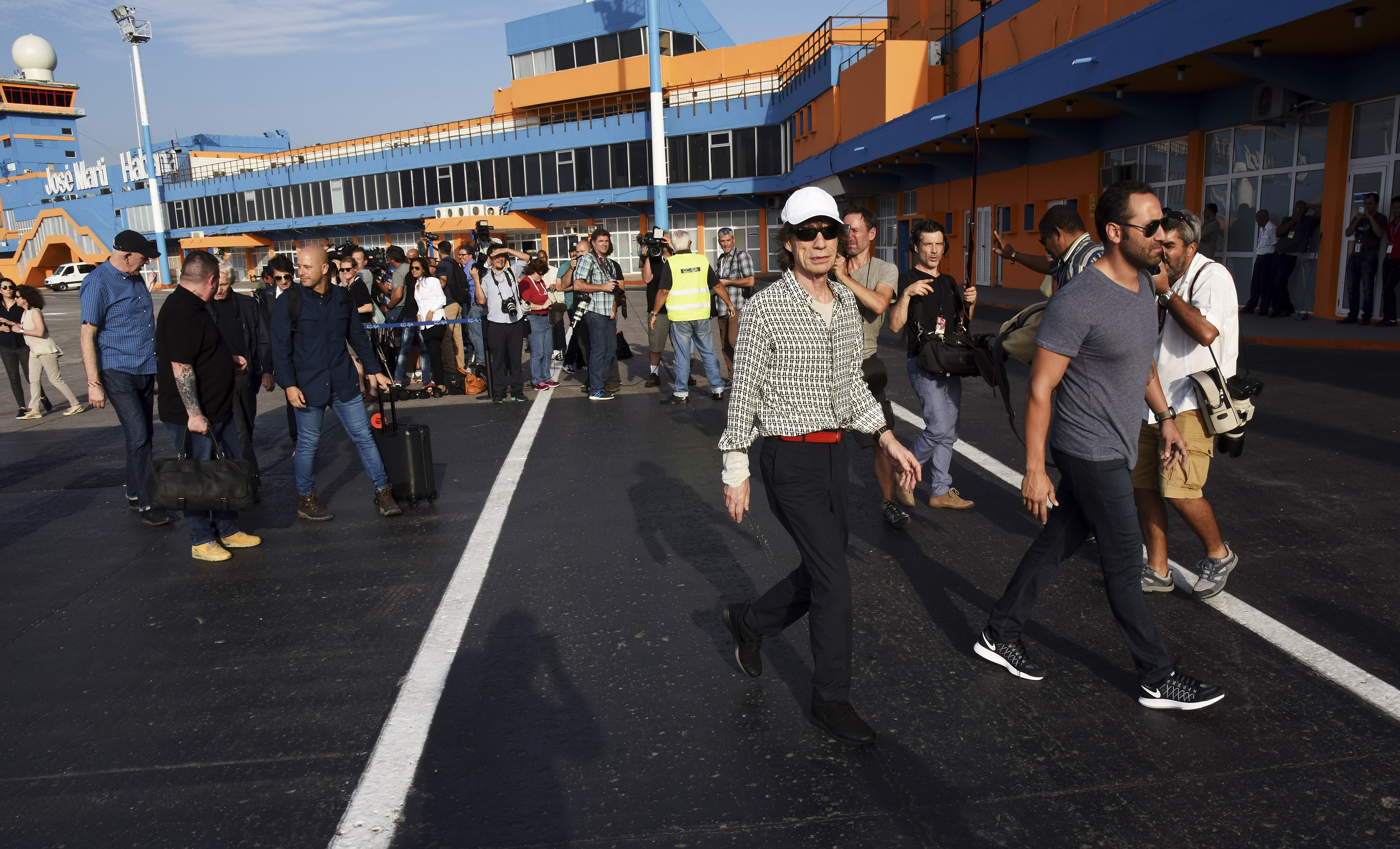 arrive for their concert in Havana at Jose Marti International Airport on March 24, 2016 in Havana, Cuba.