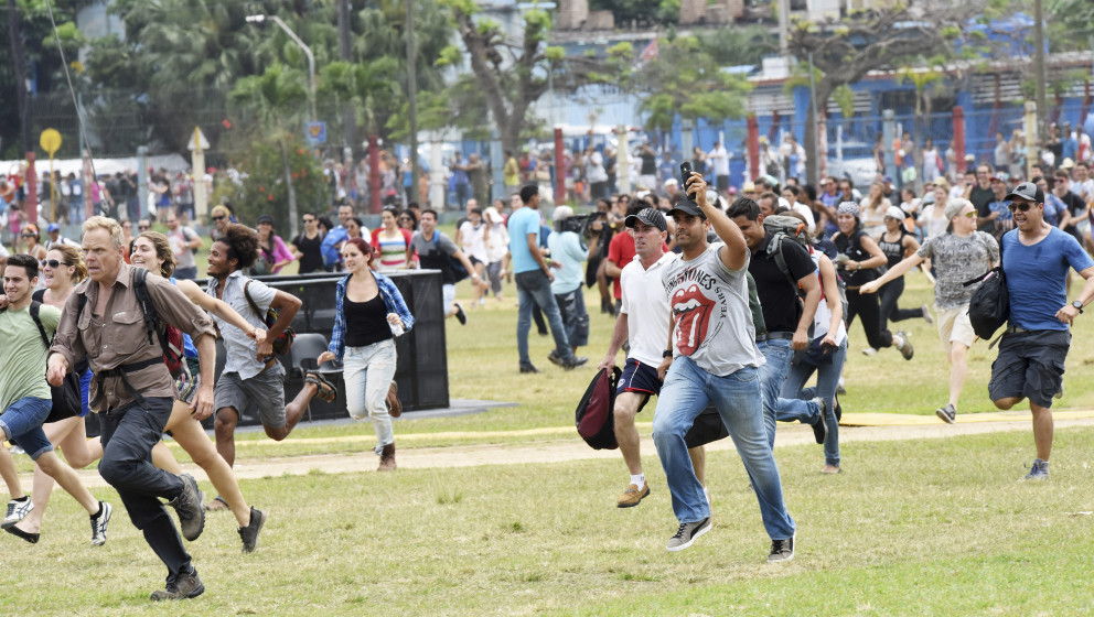 HAVANA, CUBA - MARCH 25:  Concertgoers run to claim their space before The Rolling Stones performance at Ciudad Deportiva on