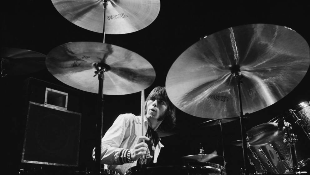 Cozy Powell, British drummer with rock band Rainbow, playing the drums for a studio portrait, in 1976. (Photo by Fin Costello