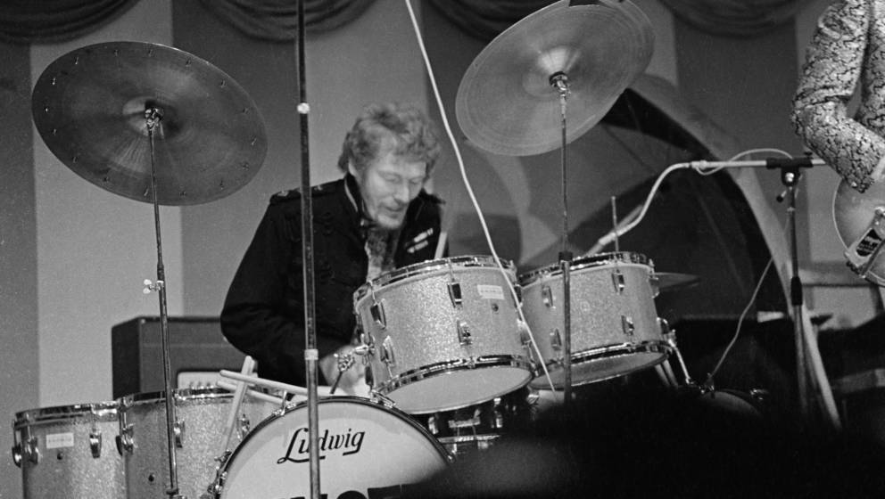 British drummer Ginger Baker performing on stage with Cream during their first live appearance at the Windsor Jazz and Blues