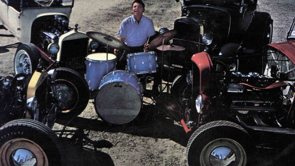 UNSPECIFIED - JANUARY 01:  (AUSTRALIA OUT) Photo of Hal BLAINE; Playing the drums surrounded by vintage cars  (Photo by GAB A