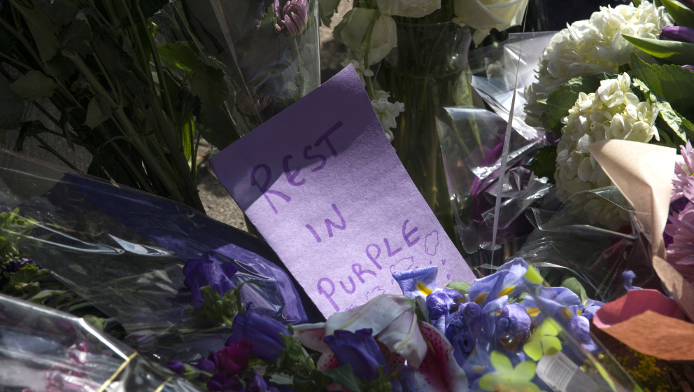 MINNEAPOLIS, MN - APRIL 21: Flowers with notes lay at a memorial for Prince outside First Avenue nightclub on April 21, 2016