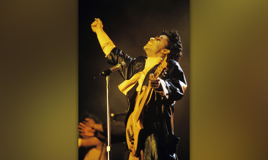 This photo taken on June 15, 1987 shows musician Prince performing on stage during his concert at the Bercy venue in Paris.