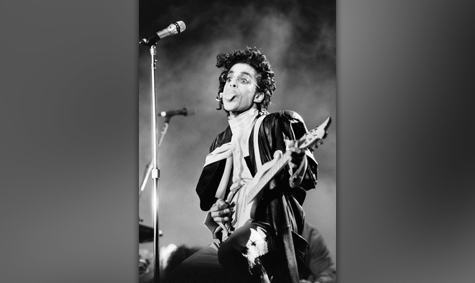 This black and white photo taken on June 15, 1987 shows musician Prince performing on stage during his concert at the Bercy v