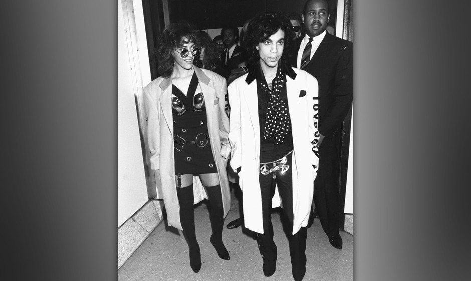 Singers Sheila E (left) and Prince arriving for a tour of Britain, July 25th 1988. (Photo by Dave Hogan/Getty Images) *** Loc