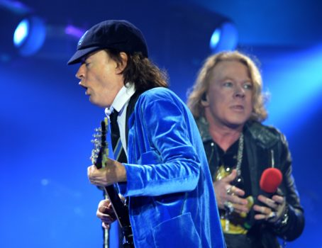Australian rock band AC/DC's guitarist Angus Young (L) and US singer Axl Rose (R) perform on stage in Marseille, southern France, on May 13, 2016. / AFP / BORIS HORVAT (Photo credit should read BORIS HORVAT/AFP/Getty Images)