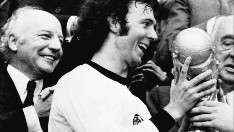 Germany's soccer star and team captain Franz Beckenbauer receives the World Soccer Cup won by his team after a 2-1 victory ov