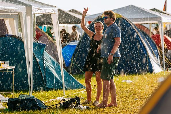 NEUHAUSEN, GERMANY - JUNE 24:  Visitor are seen in the rain during the Southside festival on June 24, 2016 in Neuhausen, Germ