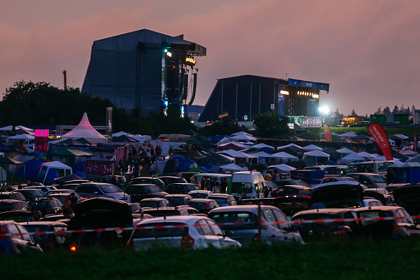 NEUHAUSEN, GERMANY - JUNE 24:  Visitors leave the camping ground to go to the cars to find a save place and avoid heavy weath