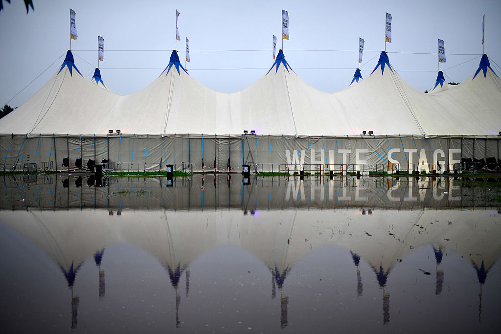 SCHEESSEL, GERMANY - JUNE 25: The White Stage is reflected in a puddle at the Hurricane Festival compound on June 25, 2016 in