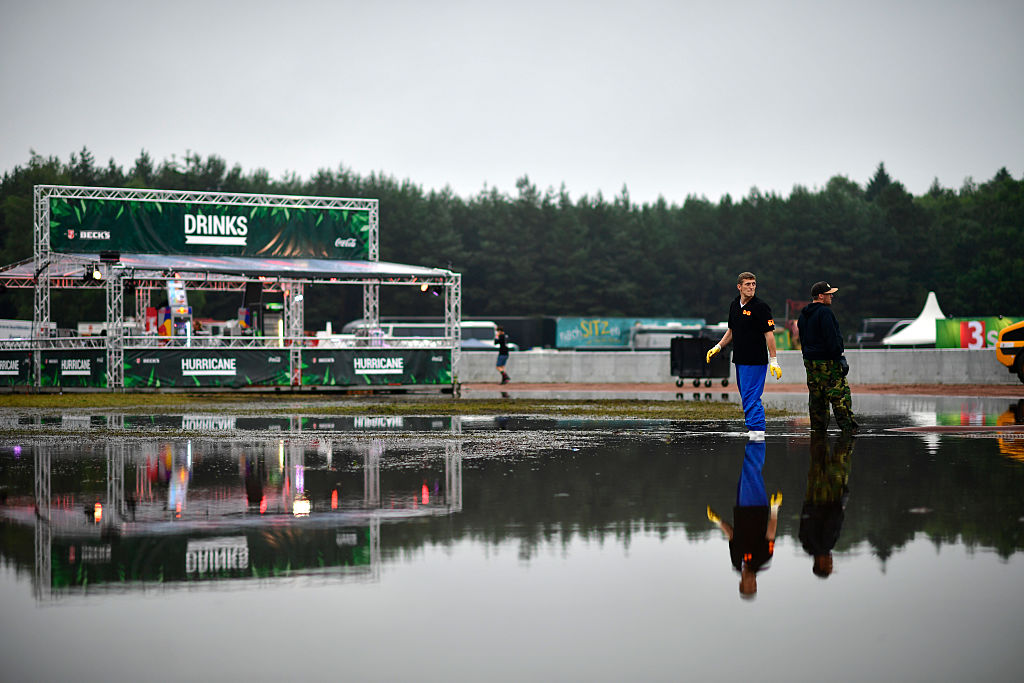 SCHEESSEL, GERMANY - JUNE 25: Service personal stand in a puddle at the Hurricane Festival compound on June 25, 2016 in Schee