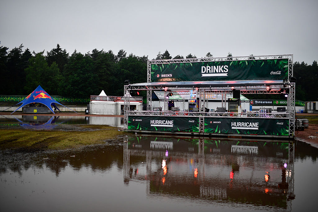 SCHEESSEL, GERMANY - JUNE 25: A drink shop is reflected in a puddle at the Hurricane Festival compound on June 25, 2016 in Sc