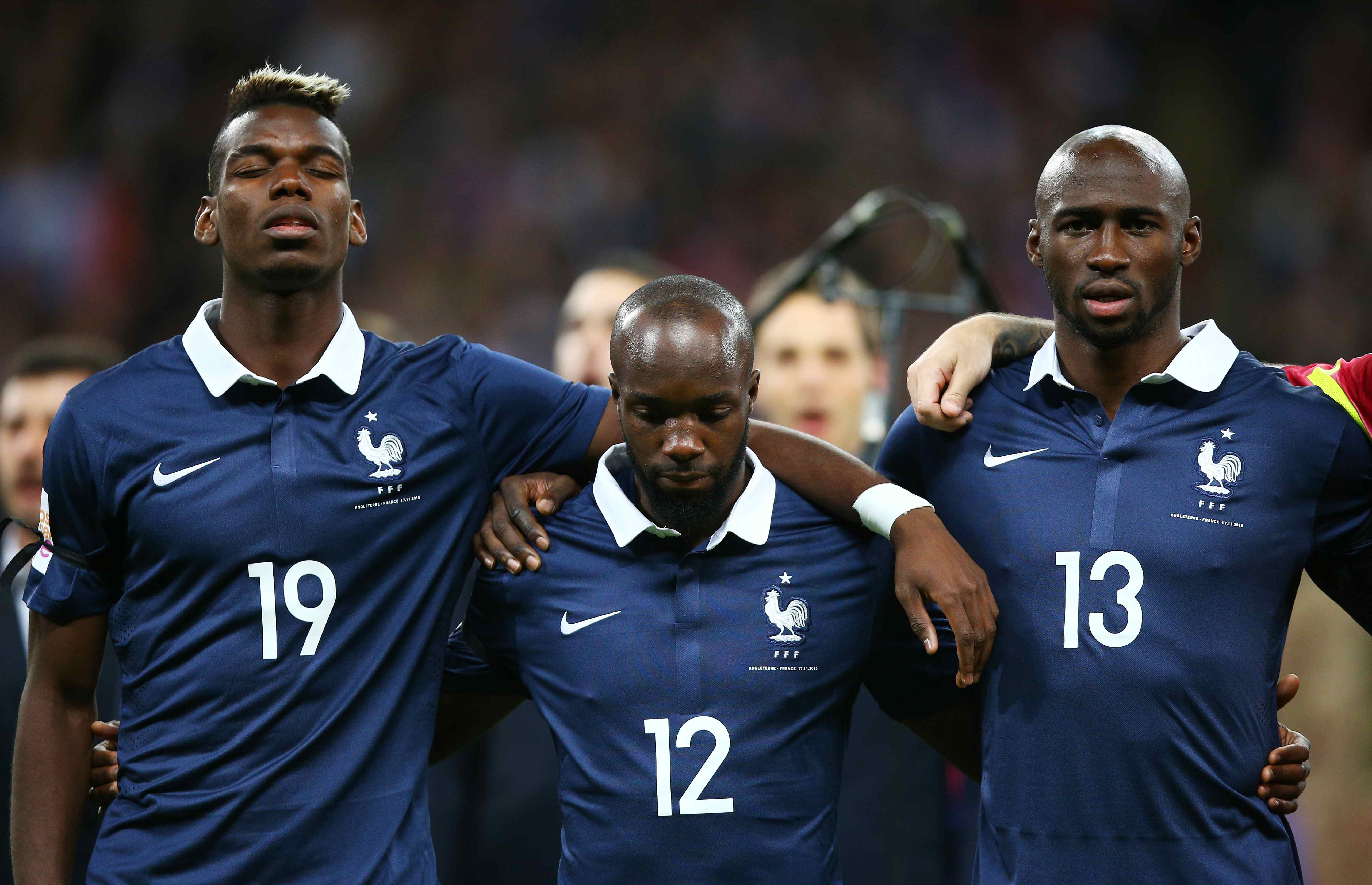 LONDON, ENGLAND - NOVEMBER 17: (L to R) Paul Pogba, Lassana Diarra and Eliaquim Mangala of France line up for the national an