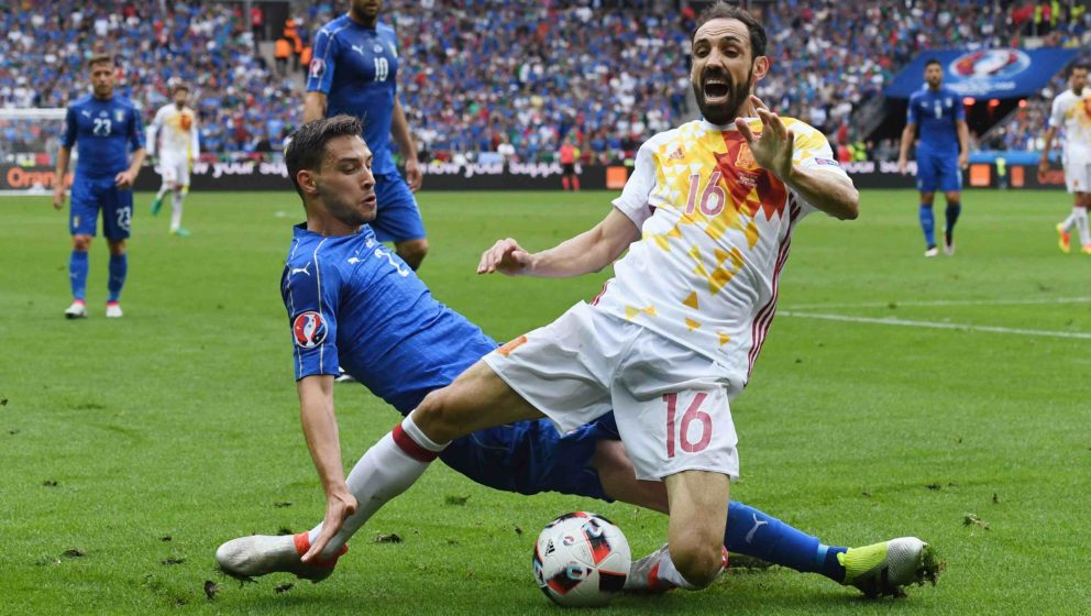 PARIS, FRANCE - JUNE 27:  Juanfran of Spain is tackled by Mattia De Sciglio of Italy during the UEFA EURO 2016 round of 16 ma