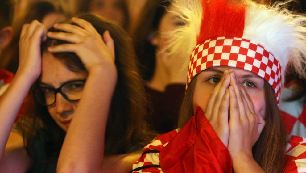 epa05391291 Croatian fans in Ban Jelacic square in Zagreb, Croatia, 25 June 2016, react after they watched their team losing