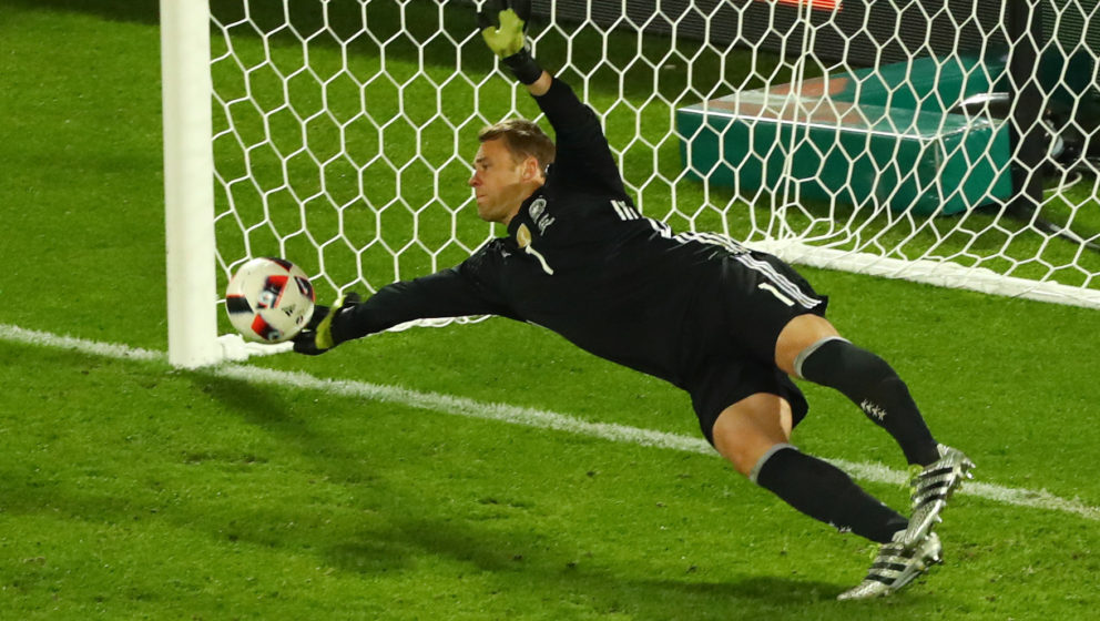 Germany's goal keeper Manuel Neuer saves the penalty shot of Italy's Leonardo Bonucci during the UEFA EURO 2016 quarter final