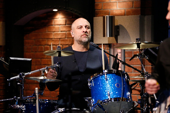 LATE NIGHT WITH SETH MEYERS -- Episode 375 -- Pictured: Tim Alexander of the band 'Primus' sits in with the 8G Band on May