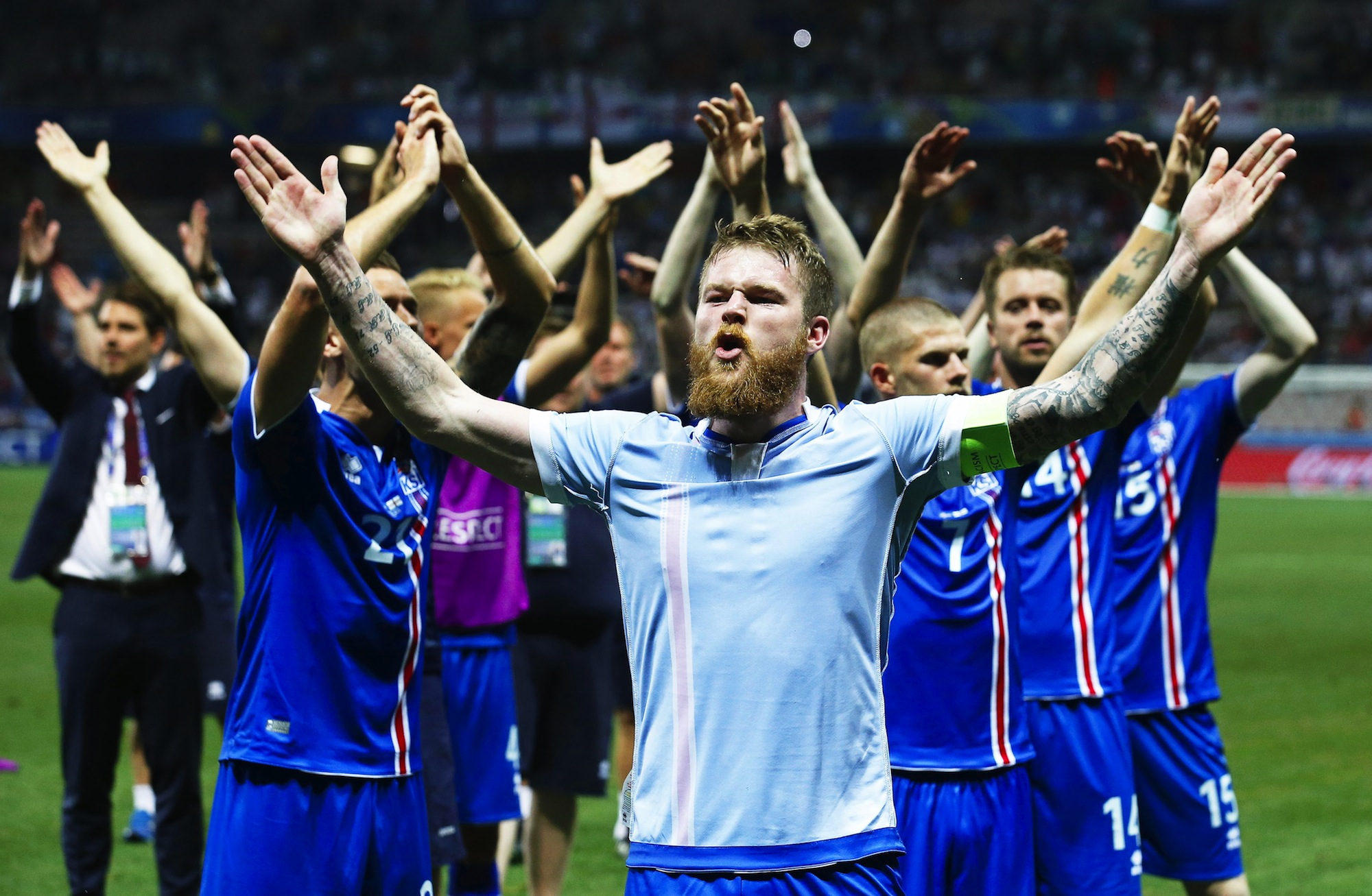 (FILE) Aron Gunnarsson (front) of Iceland and his teammates celebrate after the UEFA EURO 2016 round of 16 match between Engl