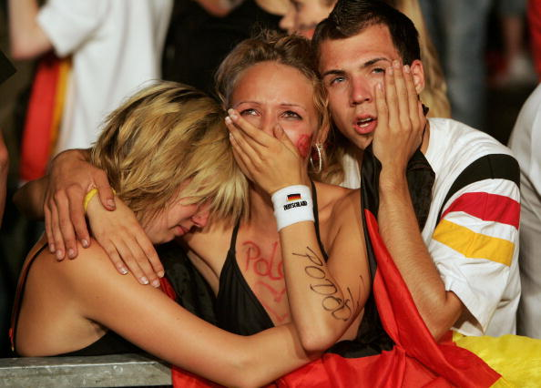 BERLIN - JULY 4:  Weeping Germany soccer fans console one another after watching the FIFA World Cup 2006 Semi Finals match be