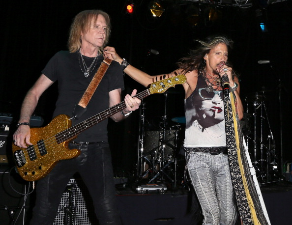 WEST HOLLYWOOD, CA - APRIL 08:  Recording artists Tom Hamilton (L) and Steven Tyler of Aerosmith perform on stage where Aeros