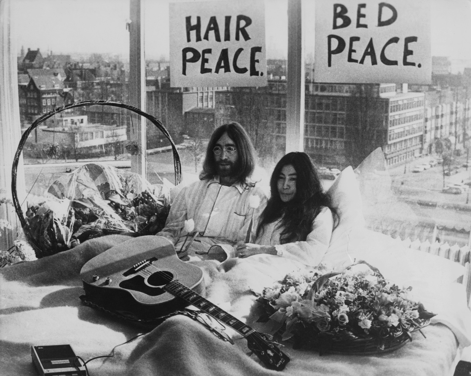 Beatle John Lennon (1940 ? 1980) and his wife of a week Yoko Ono in their bed in the Presidential Suite of the Hilton Hotel,