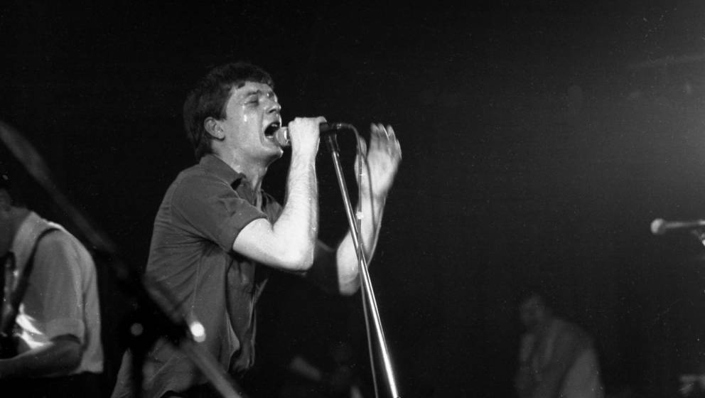 Ian Curtis of Joy Division performs on stage at the Rainbow Theatre, London, 4th April 1980. (Photo by Chris Mills/Redferns)