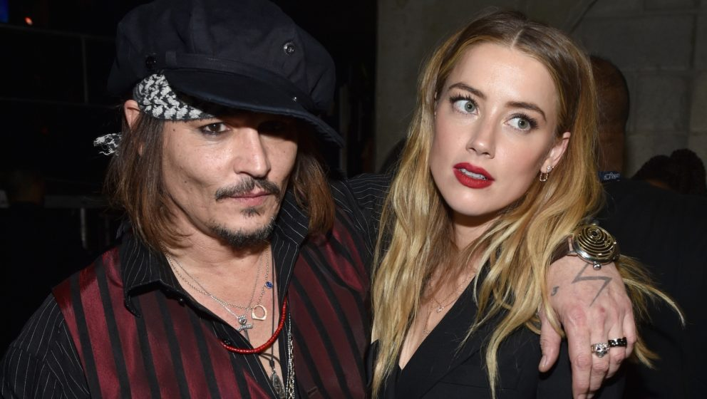 LOS ANGELES, CA - FEBRUARY 15:  Actor/musician Johnny Depp (L) and actress Amber Heard attend The 58th GRAMMY Awards at Stapl