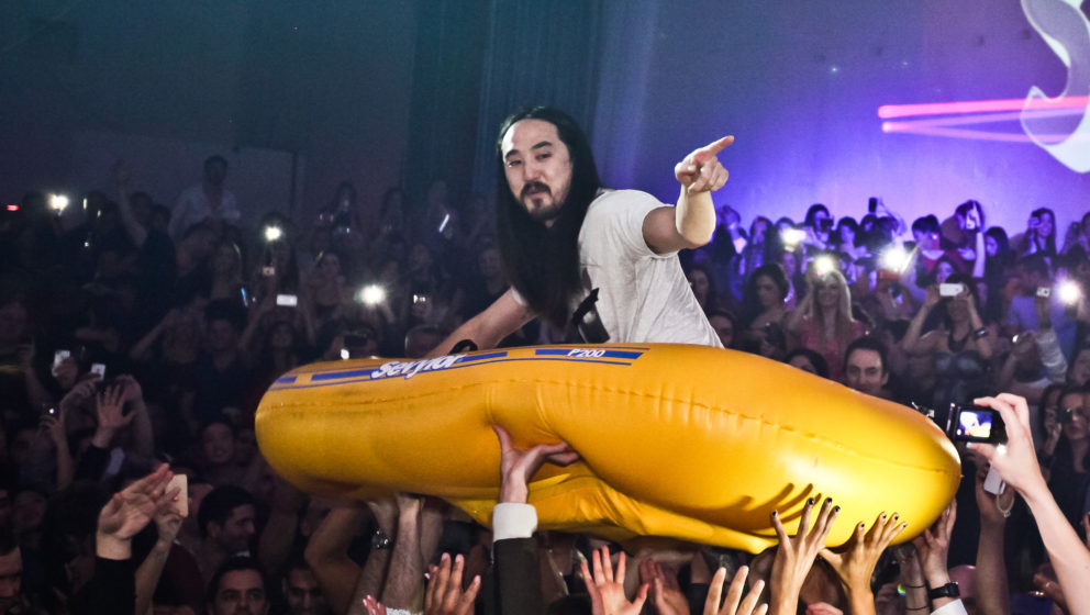 LOS ANGELES, CA - JANUARY 18:  DJ Steve Aoki crowdsurfs in a yellow raft at his record release event celebrating 'Wonderland'