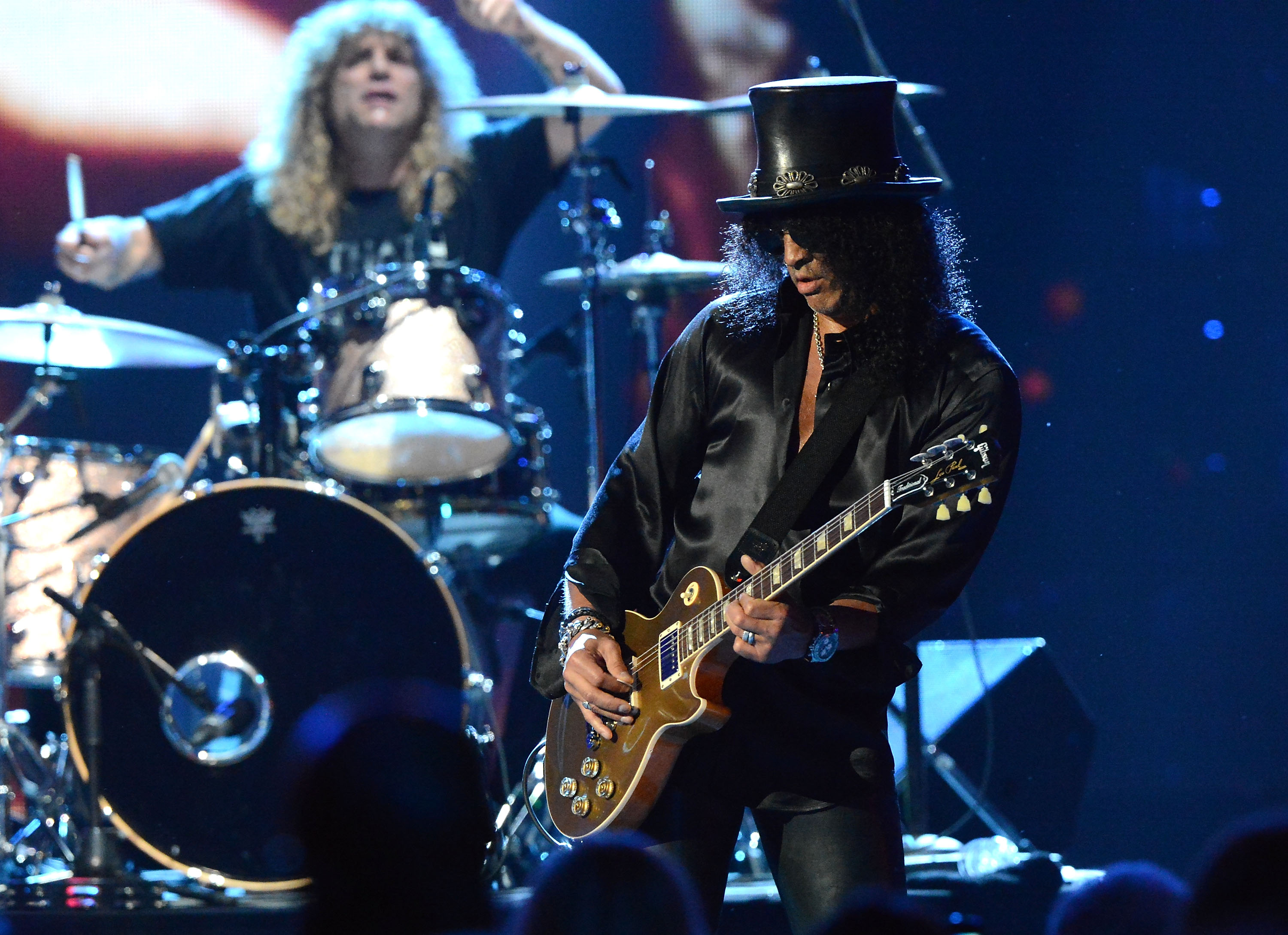 CLEVELAND, OH - APRIL 14:  Inductees Steven Adler (L) and Slash perform on stage at the 27th Annual Rock And Roll Hall Of Fam