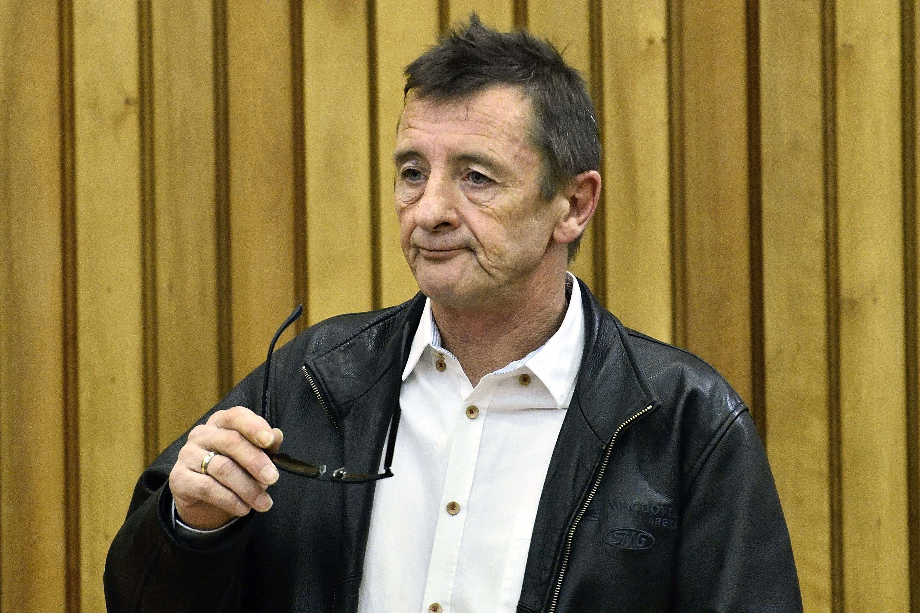 Former AC/DC drummer Phil Rudd stands in the dock at the District Court after violating the conditions on his sentenced 8 mon