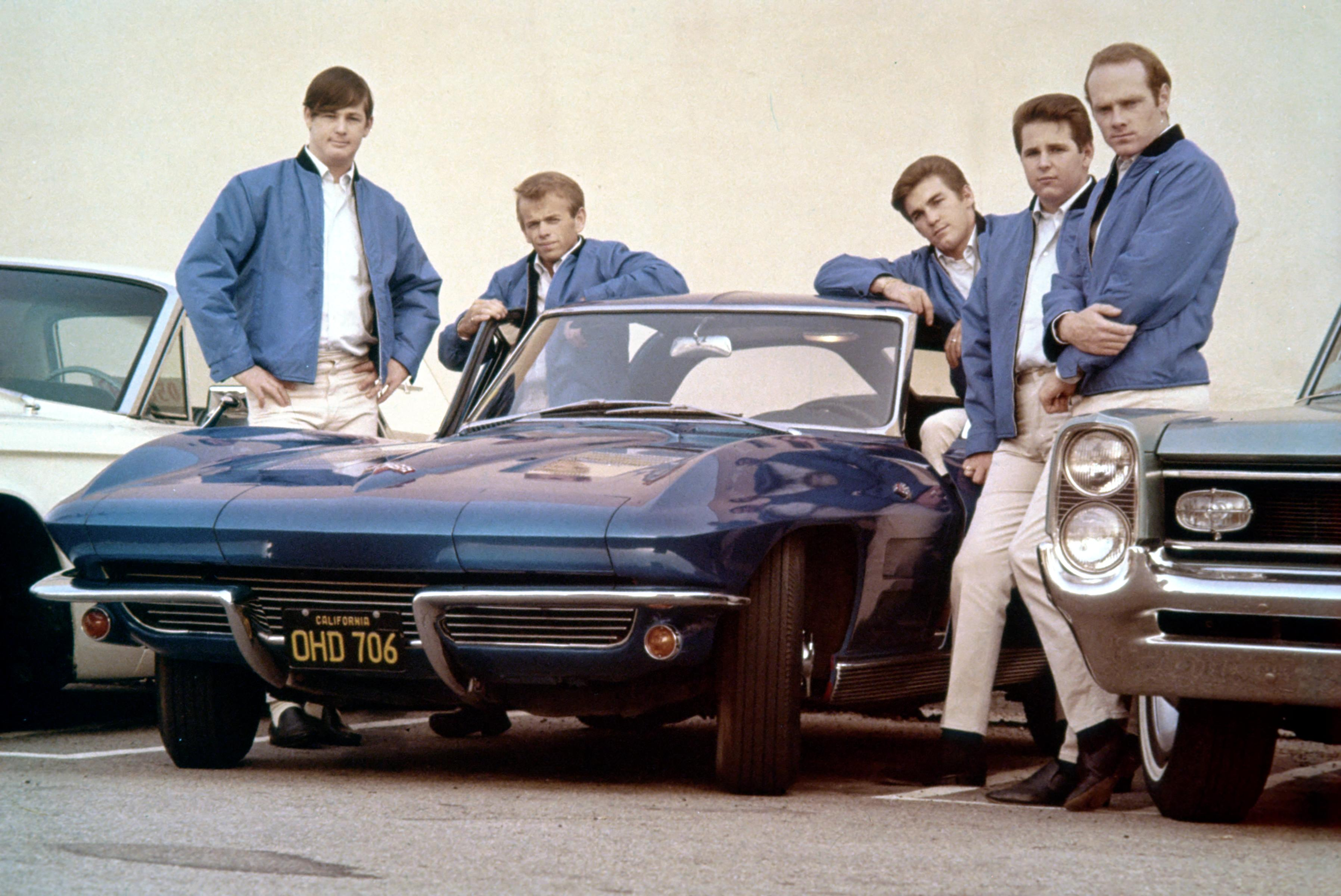LOS ANGELES - NOVERMBER 1963: Rock and roll group 'The Beach Boys' pose with Corvette in their first photo session since Al J