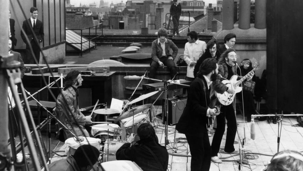 30th January 1969:  British rock group the Beatles performing their last live public concert on the rooftop of the Apple Orga