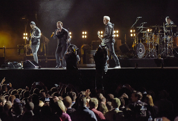SAN FRANCISCO, CA - OCTOBER 05:  (L-R) The Edge, Bono, Adam Clayton, and Larry Mullen Jr. of U2 perform during the UCSF Benio