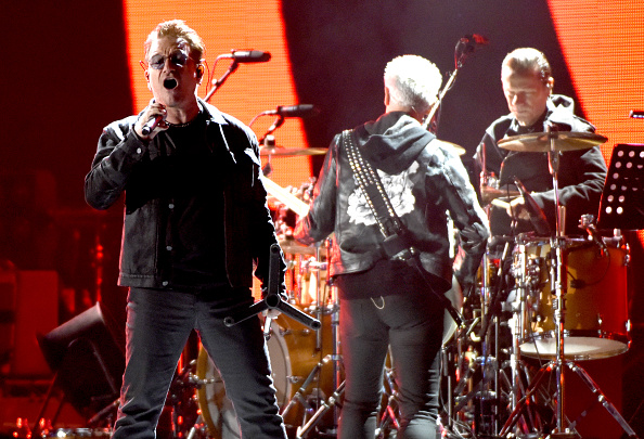 SAN FRANCISCO, CA - OCTOBER 05:  (L-R) Bono, Adam Clayton, and Larry Mullen Jr. of U2 perform during the UCSF Benioff Childre
