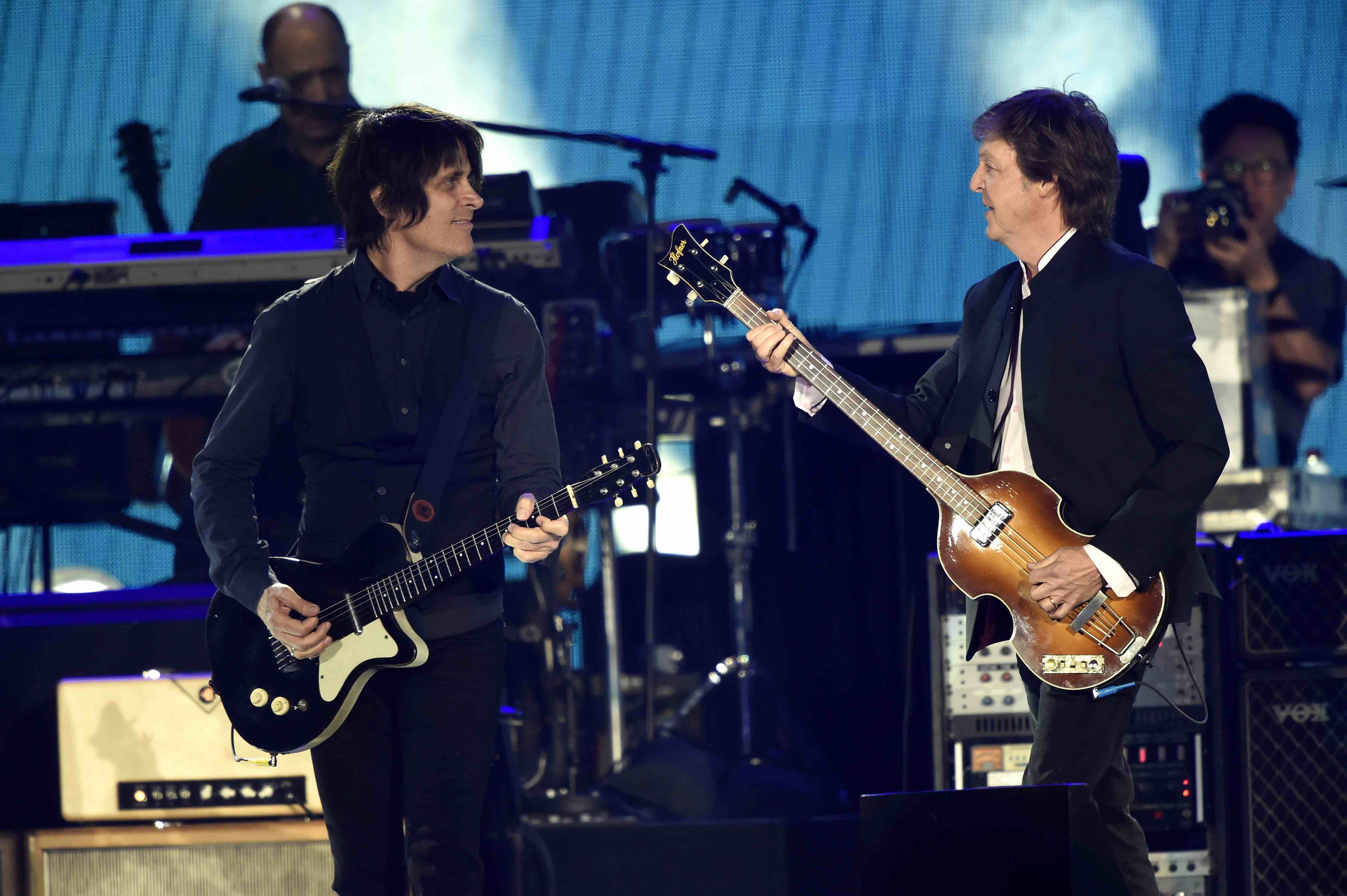 INDIO, CA - OCTOBER 08:  Musicians Paul McCartney (R) and Rusty Anderson perform onstage during Desert Trip at The Empire Pol