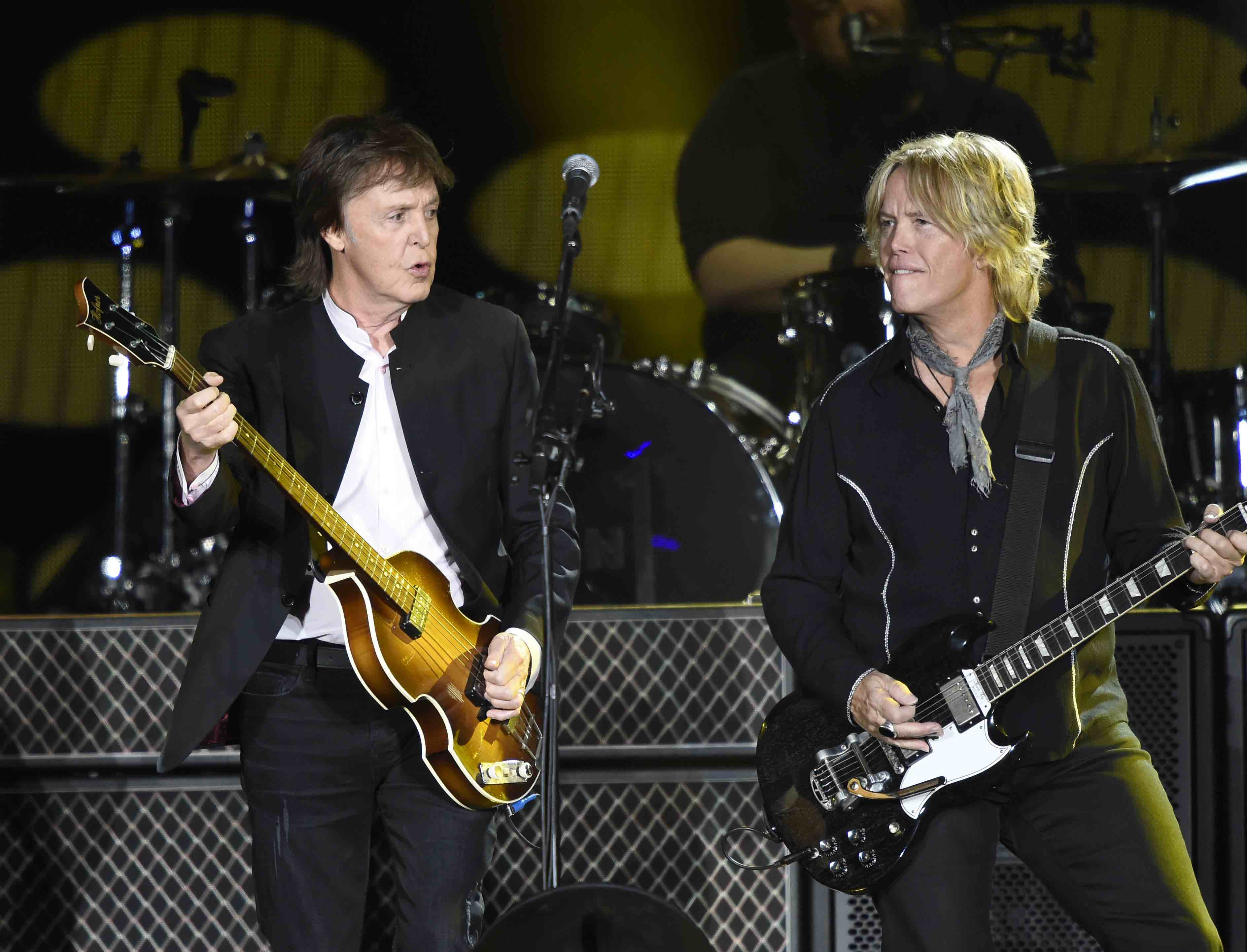 INDIO, CA - OCTOBER 08:  Musicians Paul McCartney (L) and Brian Ray walk onstage during Desert Trip at The Empire Polo Club o