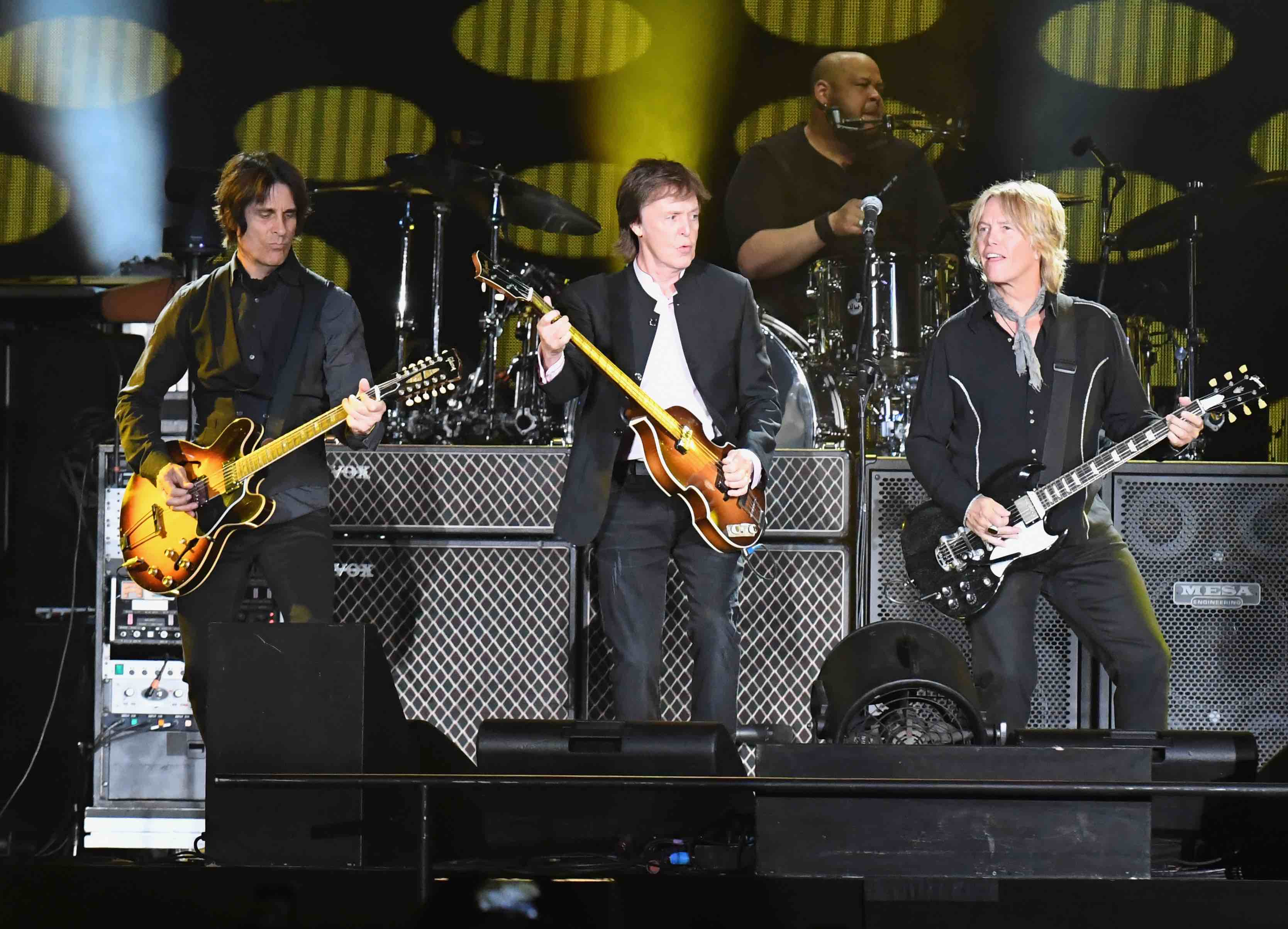 INDIO, CA - OCTOBER 08:  (L-R) Guitarist Rusty Anderson, Sir Paul McCartney and Brian Ray perform onstage during Desert Trip