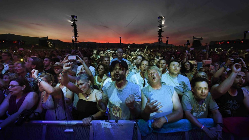 Fans react as they watch The Who perform during the third day of the Desert Trip music festival at Indio, California on Octob