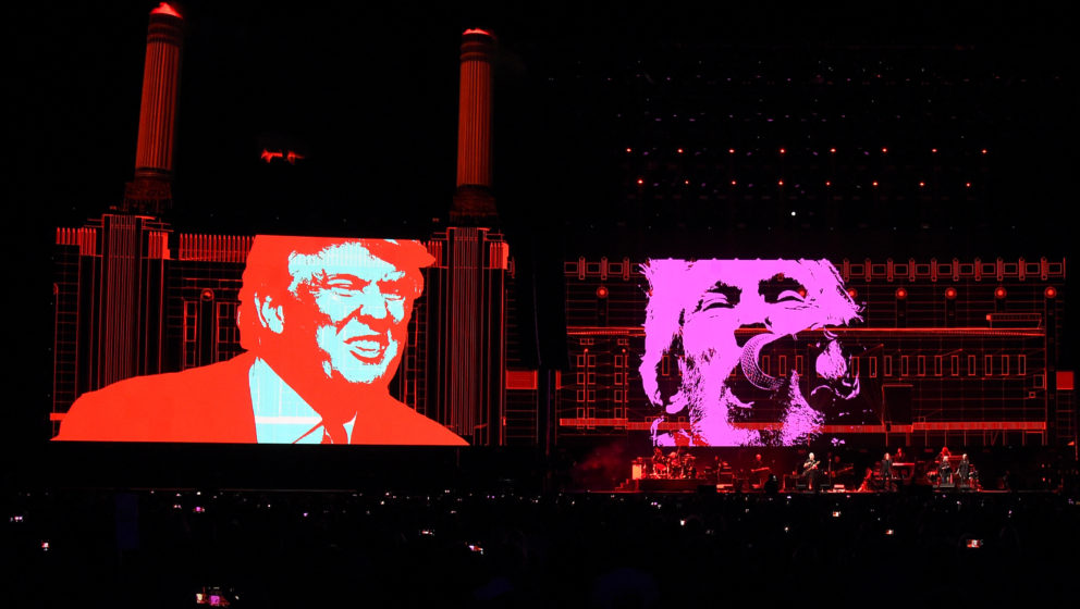 INDIO, CA - OCTOBER 09:  An illustration of Donald Trump (L) appears on the screen during Roger Waters performance at Desert