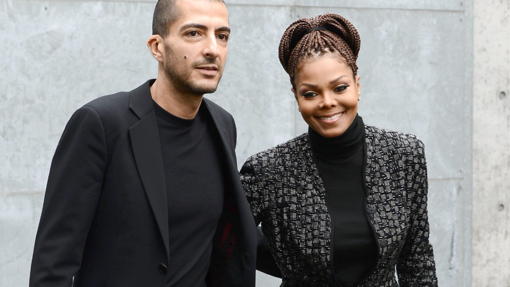 MILAN, ITALY - FEBRUARY 25:  Wissam al Mana and Janet Jackson attend the Giorgio Armani fashion show during Milan Fashion Wee