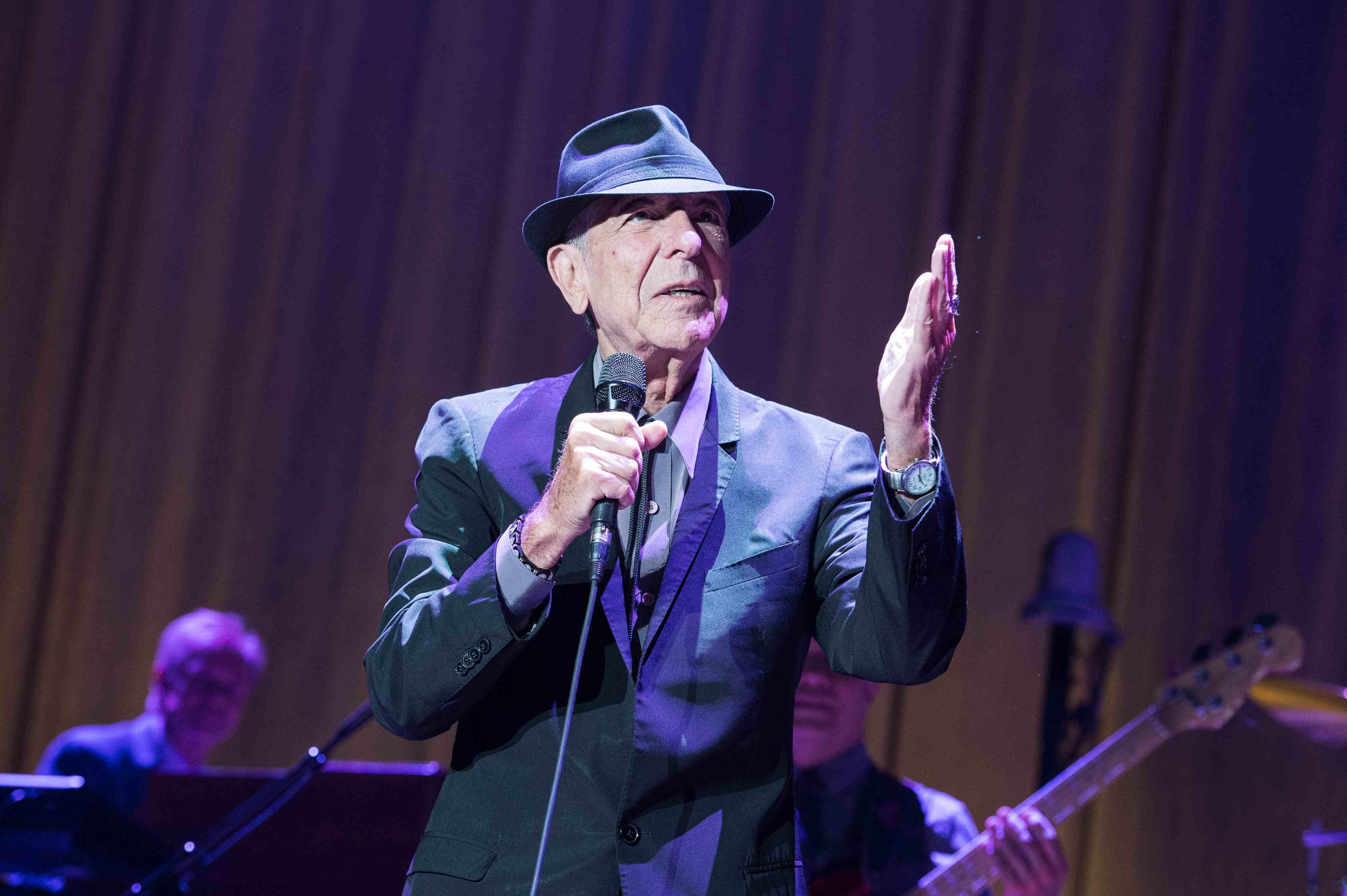 PARIS, FRANCE - JUNE 18: Leonard Cohen performs at Palais Omnisports de Bercy on June 18, 2013 in Paris, France. (Photo by Da