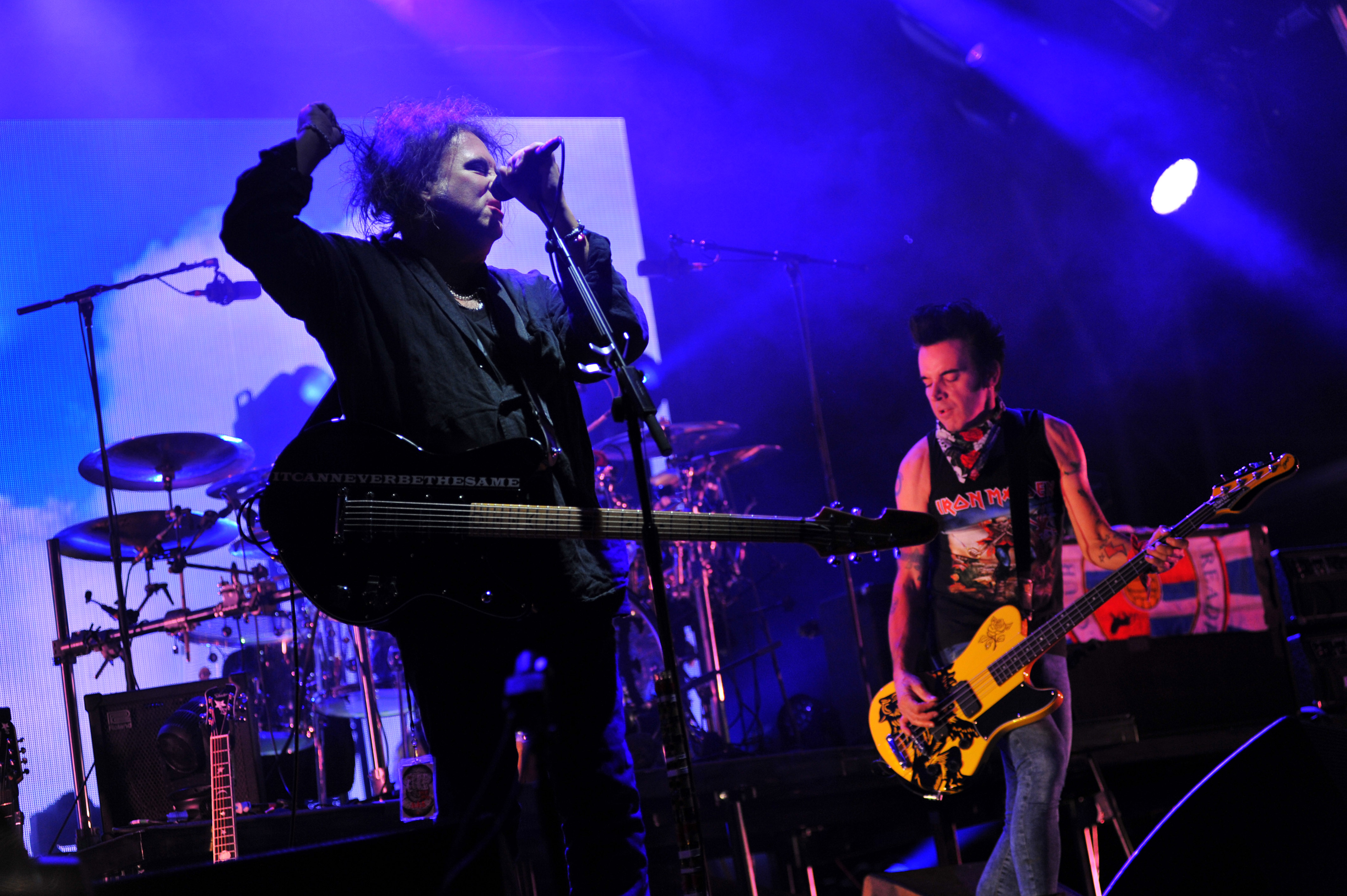 NEWPORT, ISLE OF WIGHT - SEPTEMBER 10:  Robert Smith and Simon Gallup of  The Cure headline on the Main Stage during Day 3 of