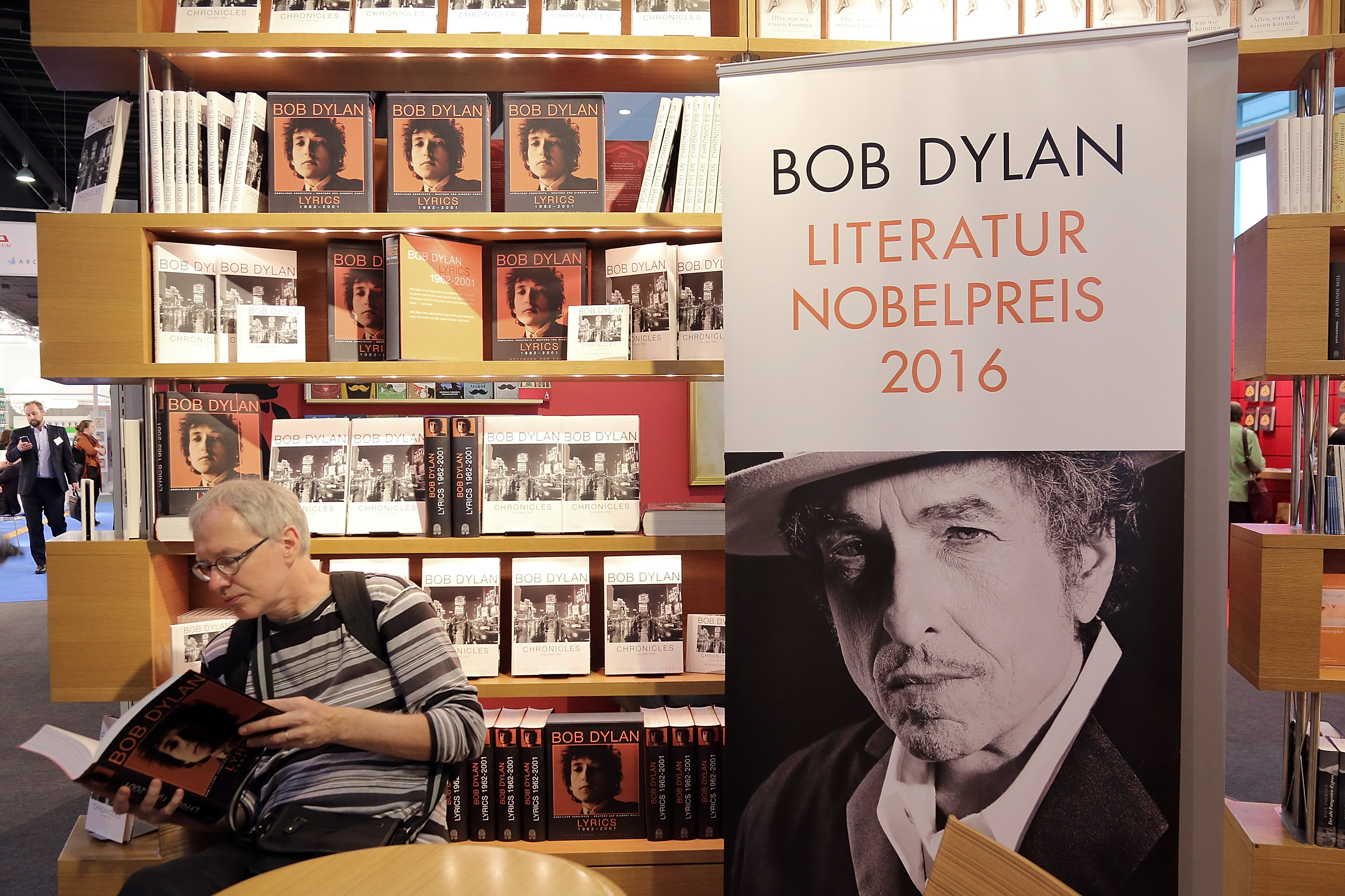 FRANKFURT AM MAIN, GERMANY - OCTOBER 19:  A man reads a book about Bob Dylan at the 2016 Frankfurt Book Fair (Frankfurter Buc