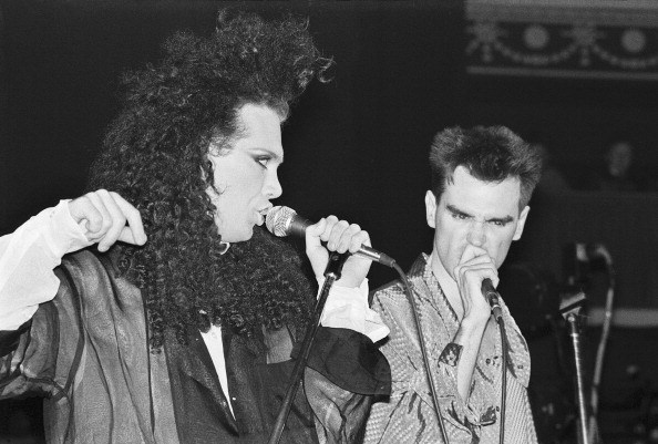 Pete Burns and Morrissey perform  live on stage with The Smiths at The Royal Albert Hall, London, 05 April 1985. (Photo by Ph