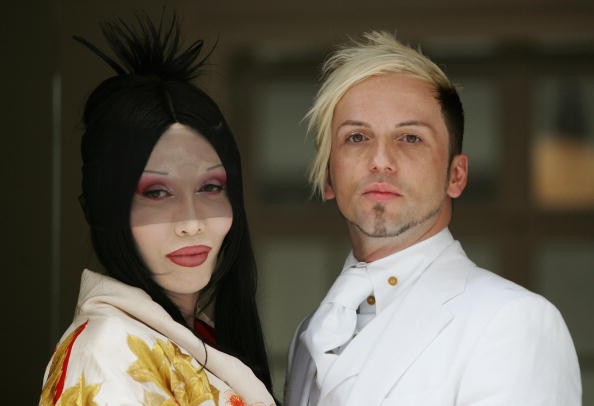 LONDON - JULY 06:  (L-R) Pete Burns and Michael Simpson arrive at the Royal Society of Arts for their Civil Partnership Cerem