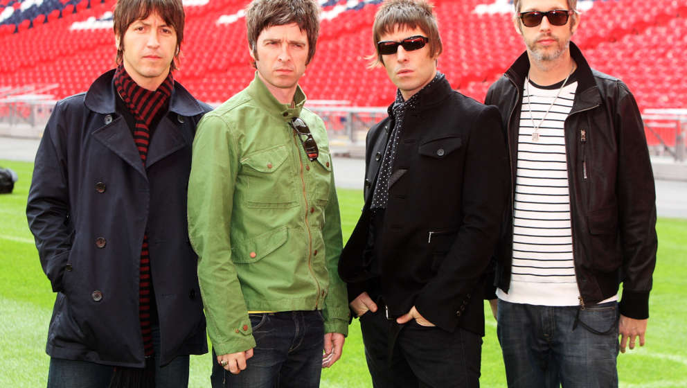 LONDON - OCTOBER 16: L-R Gem Archer, Noel Gallagher, Liam Gallagher and Chris Sharrock attend the Oasis photocall in Wembley