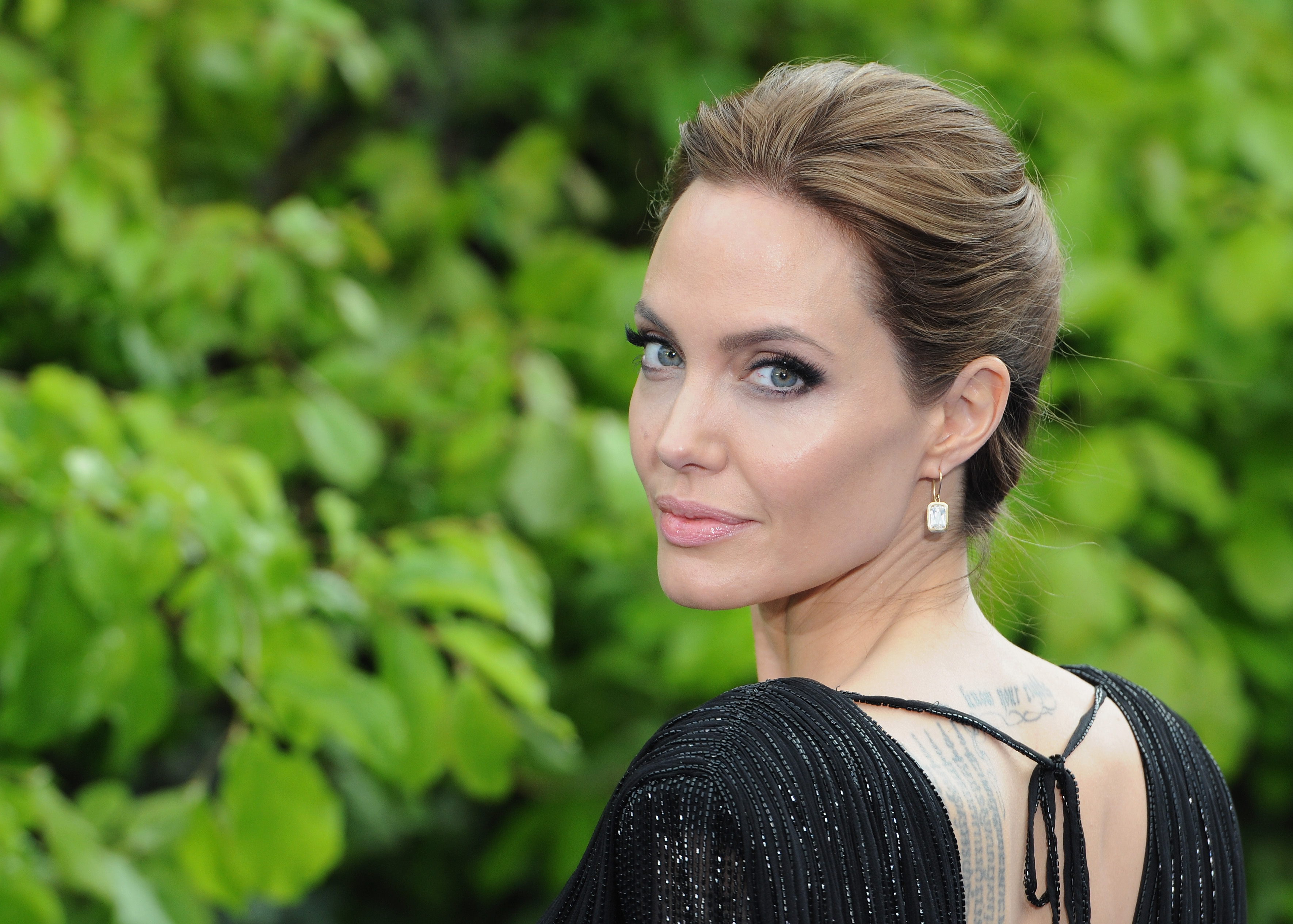 LONDON, ENGLAND - MAY 08:  Angelina Jolie attends a private reception as costumes and props from Disney's 'Maleficent' are ex