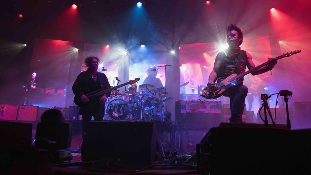 BOLOGNA, ITALY - OCTOBER 29:  Robert Smith (L) and simon Gallup (R) leads the Cure in concert at Unipol Arena on October 29,