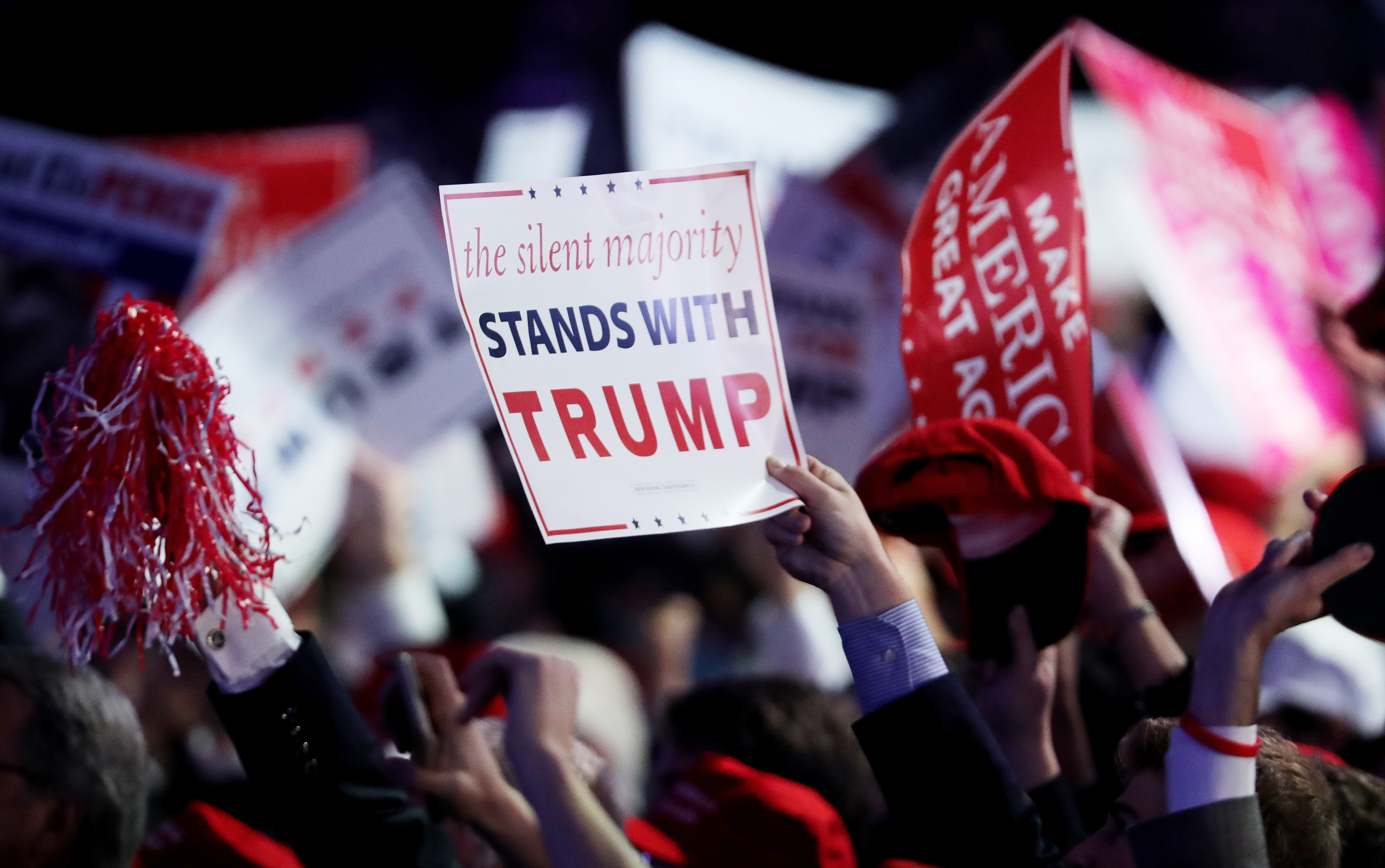 NEW YORK, NY - NOVEMBER 09:  People hold up a sign in support of Republican presidential nominee Donald Trump during the elec